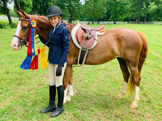 Caroline Smith of Mountain Home was Champion at the Northwest Arkansas Hunter Jumper Association June Horse Show held June 9 at Legends Equestrian Center in Bentonville. Smith and her registered Welsh Pony, American Girl, aka Dolly, competed in the 2 ft. Amateur Hunter Division.
