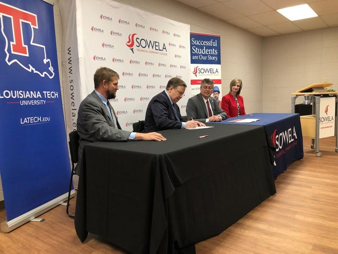 Louisiana Tech University President Les Guice (second from left) signs the memorandum of understanding with SOWELA Technical Community College. Also pictured are (from left) Joshua Adams, SOWELA ChancellorNeil Aspinwall andPaula Hellums,SOWELAVice Chancellor for Academic Affairs.