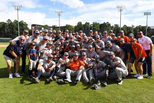 The Auburn baseball team poses for a picture after winning the Chapel Hill Super Regional against North Carolina on Monday, June 10, 2019, in Chapel Hill, NC.