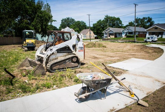 """Debris and weeds are cleared from a lot at Kilgore Avenue and Jackson Street where the city plans to build a """"gateway"""" into downtown Muncie."""