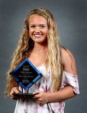 The Daily News Journal All Sports Female Athlete of the Year Award winner Caitlyn McCrary of Siegel holds up her award on Tuesday, June 11, 2019.