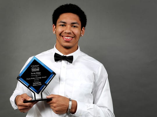 The Daily News Journal All Sports Travis Weber Courage Award winner Tevin Shipp of Smyrna holds up his award on Tuesday, June 11, 2019.