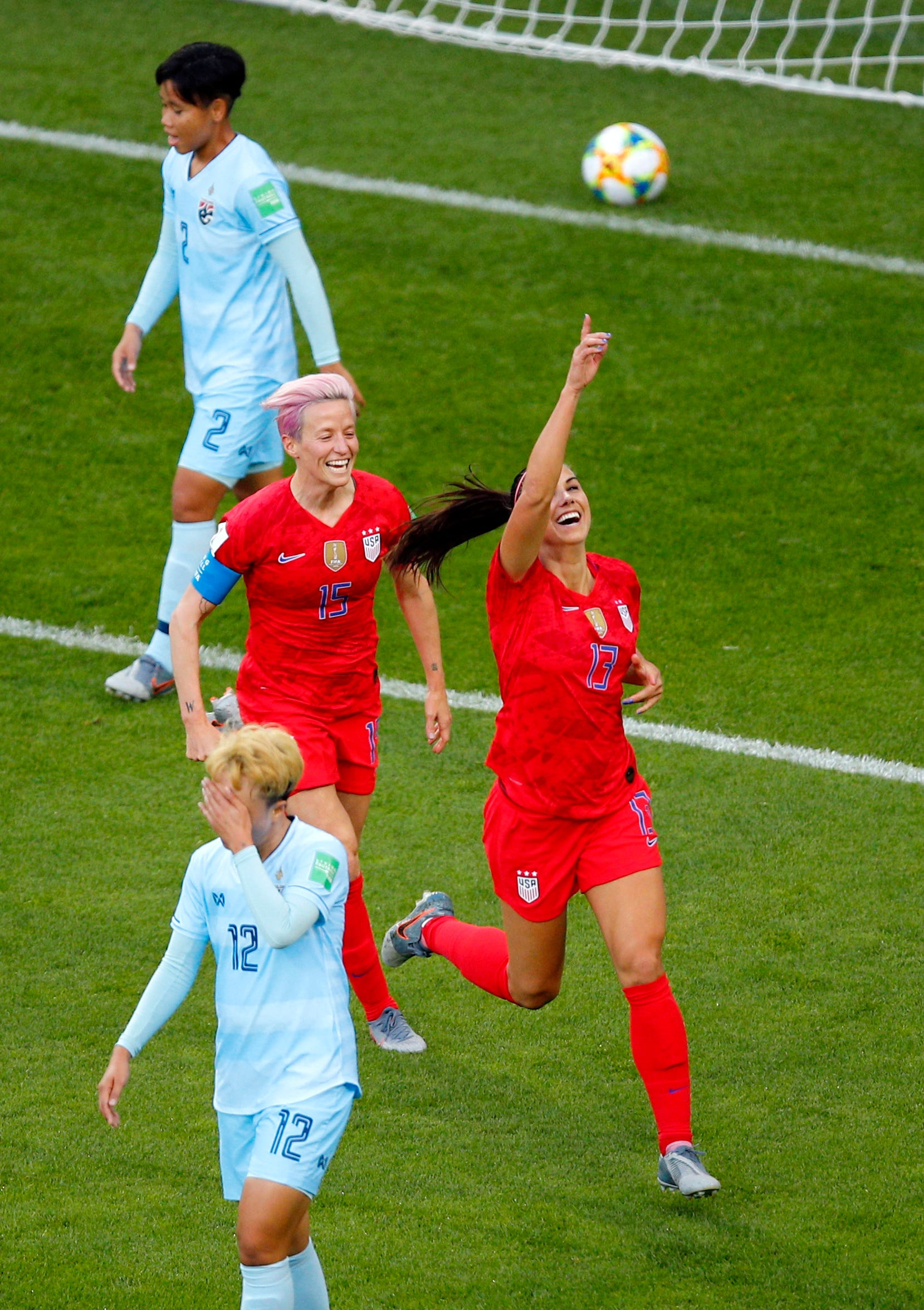 United States' Alex Morgan, right, celebrates after scoring her team's first goal during the Women's World Cup Group F soccer match between the USA and Thailand at the Stade Auguste-Delaune in Reims, France, Tuesday, June 11, 2019.