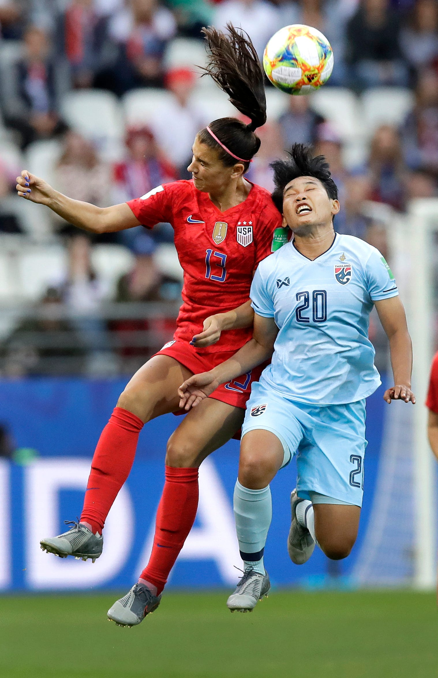 United States' Alex Morgan, left, and Thailand's Wilaiporn Boothduang, right, challenge for the ball during the Women's World Cup Group F soccer match between United States and Thailand at the Stade Auguste-Delaune in Reims, France, Tuesday, June 11, 2019.