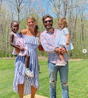 Thomas Rhett and his wife, Lauren Akins, pose with their daughters Willa Gray and Ada James on Easter Sunday.