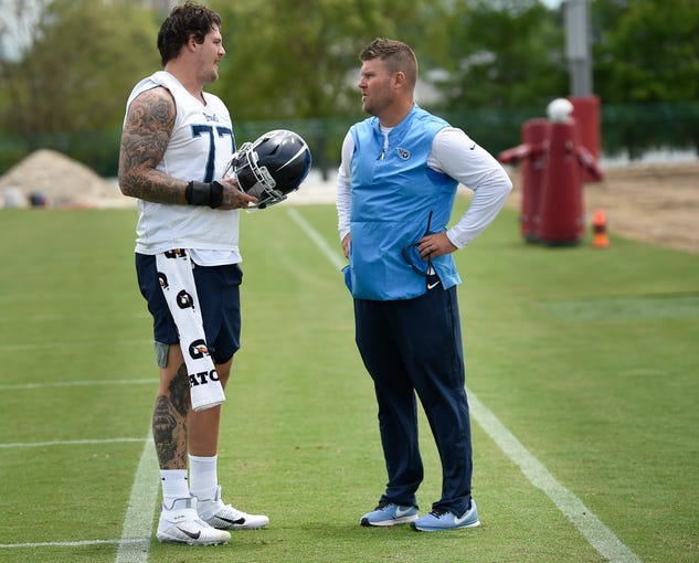 Titans offensive tackle Taylor Lewan (77) talks with general manager Jon Robinson after practice at Saint Thomas Sports Park Tuesday, June 11, 2019, in Nashville, Tenn.