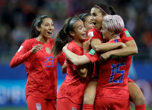 United States' Alex Morgan, second right, celebrates after scoring her side's 12th goal during the Women's World Cup Group F soccer match between United States and Thailand at the Stade Auguste-Delaune in Reims, France, Tuesday, June 11, 2019. Morgan scored five goals.match.