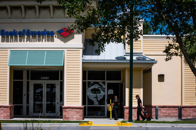 Officers enter the scene of a robbery that took place the Bank of America at 12965 Collier Blvd. in Naples on Tuesday, June 11, 2019.
