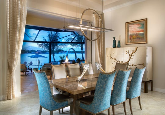 Vogue Interiors' Leslie Gebert, ASID and Licensed Interior Designer Christie Heeb have completed the remodeling of a 15-year old, 3,755 square foot residence in the Miromar Lakes Beach & Golf Club community.  The new look in the dining room is one of the new design's many highlights.