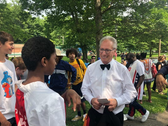 "Lou D'Amico greets well-wishers after  the ""Drums of Thunder"" of Montclair's Hillside elementary school performed at Nishuane Park's African American Heritage Day festival. June 1, 2019."
