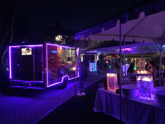 Callahan's food truck gives off some mood lighting at a graduation party.