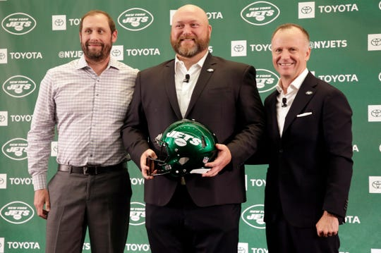 The new New York Jets general manager Joe Douglas, center, poses for a picture with head coach Adam Gase, left, and owner Christopher Johnson during a news conference at the team's NFL football training facility in Florham Park Tuesday, June 11, 2019.