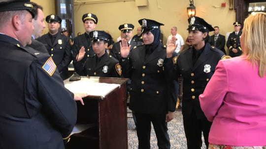 Yeniry Medina, Serein Tamimi and Gabriela Toribio  (left to right) were  sworn in as Paterson police officers in the city's first all-female class on June 11, 2019.