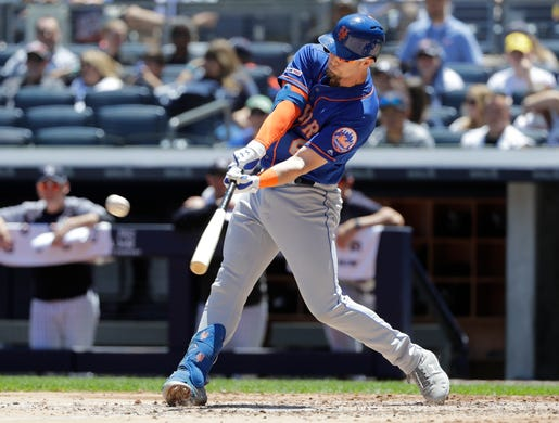 New York Mets' Jeff McNeil hits a three-run home run against the New York Yankees during the third inning in the first baseball game of a doubleheader, Tuesday, June 11, 2019, in New York. (AP Photo/Frank Franklin II)