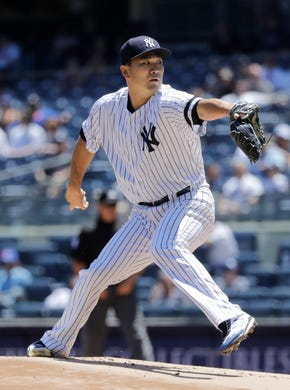 New York Yankees' Masahiro Tanaka, of Japan, delivers a pitch during the first inning in the first game of a baseball doubleheader  Tuesday, June 11, 2019, in New York. (AP Photo/Frank Franklin II)