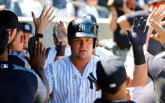Jun 11, 2019; Bronx, NY, USA; New York Yankees designated hitter Luke Voit (45) is congratulated after hitting a three run home run against the New York Mets during the fourth inning at Yankees Stadium. Mandatory Credit: Andy Marlin-USA TODAY Sports