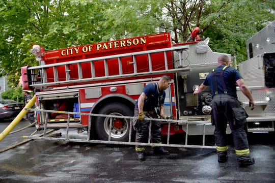 Two-alarm fire in vacant house temporarily displaces neighbors