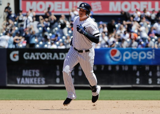New York Yankees' Gio Urshela runs the bases after hitting a two-run home run during the fourth inning in the first baseball game of a doubleheader, Tuesday, June 11, 2019, in New York. (AP Photo/Frank Franklin II)