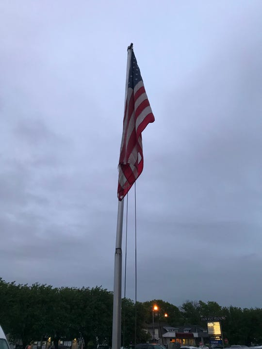 The flag in front of the Woodland Park post office on McBride Avenue. A veteran complained because the flag was not properly lit overnight.