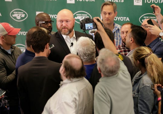 New York Jets general manager Joe Douglas, center, speaks to reporters after a news conference at the team's NFL football training facility in Florham Park Tuesday, June 11, 2019.