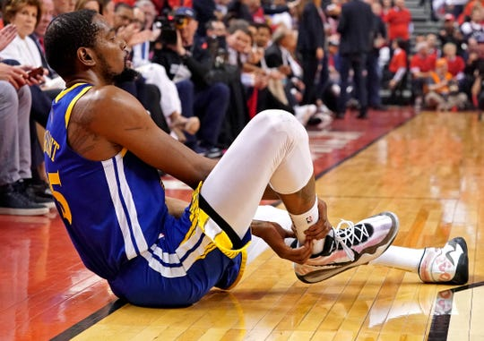 Golden State Warriors forward Kevin Durant (35) sits on the court after an apparent injury during the second quarter in game five against the Toronto Raptors of the 2019 NBA Finals at Scotiabank Arena on June 10, 2019.
