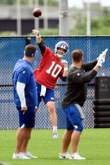 New York Giants quarterback Eli Manning throws the ball during OTAs on Tuesday, June 11, 2019, in East Rutherford.
