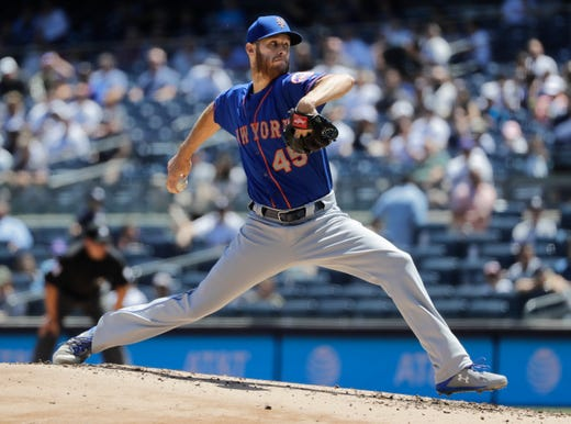 New York Mets' Zack Wheeler delivers a pitch during the first inning in the first game of a baseball doubleheader Tuesday, June 11, 2019, in New York. (AP Photo/Frank Franklin II)