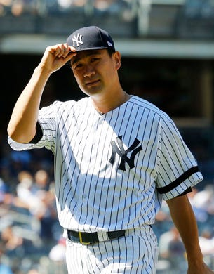 Jun 11, 2019; Bronx, NY, USA; New York Yankees starting pitcher Masahiro Tanaka (19) tips his cap to the fans after being taken out of the game against the New York Mets during the seventh inning at Yankees Stadium. Mandatory Credit: Andy Marlin-USA TODAY Sports