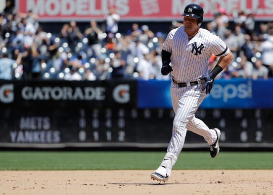 New York Yankees' Luke Voit runs the bases after hitting a three-run home run against the New York Mets during the fourth inning in the first baseball game of a doubleheader, Tuesday, June 11, 2019, in New York. (AP Photo/Frank Franklin II)