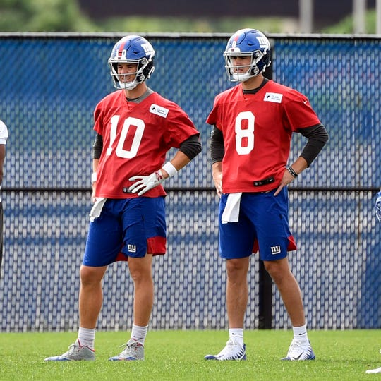 New York Giants veteran quarterback Eli Manning (10) and rookie quarterback Daniel Jones (8) on the field for OTAs on Tuesday, June 11, 2019, in East Rutherford.