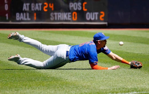 Jun 11, 2019; Bronx, NY, USA; New York Mets second baseman Jeff McNeil (6) makes a diving attempt to catch an RBI single by New York Yankees catcher Gary Sanchez (not pictured) during the third inning at Yankees Stadium. Mandatory Credit: Andy Marlin-USA TODAY Sports