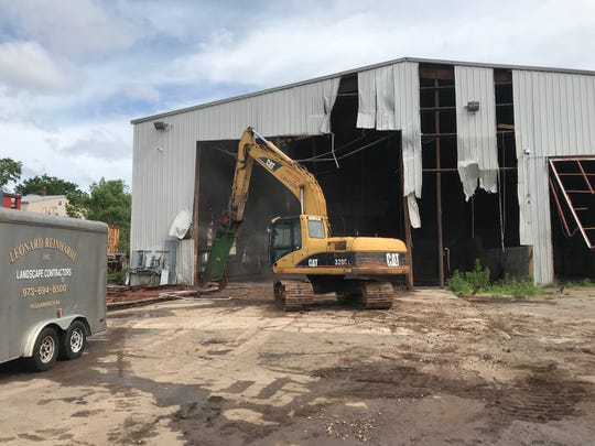 Demolition crews knocked apart the New York and Greenwood Lake Railroad's  shed on Tuesday.