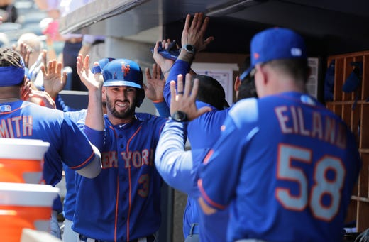 New York Mets' Tomas Nido (3) celebrates with teammates after scoring on a three-run home run by teammate Jeff McNeil during the third inning against the New York Yankees in the first baseball game of a doubleheader, Tuesday, June 11, 2019, in New York. (AP Photo/Frank Franklin II)