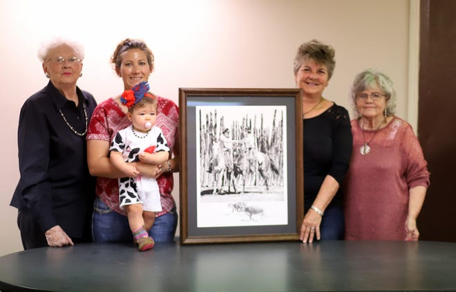"""BorderBelles members, from left, Dona Irwin, Karen Reed, with baby Aliee, Gwyn Ruebush and Arline Medlin show the Robert """"Shoofly"""" Shufelt drawing, """"The Contract,"""" that will be presented to one lucky winner in a drawing later this year. The BorderBelles will host their Beef for Father's Day promotion from 10 a.m. to 2 p.m. on Saturday at Peppers Supermarket."""