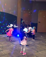 Story time participants take part in a bubble dance.