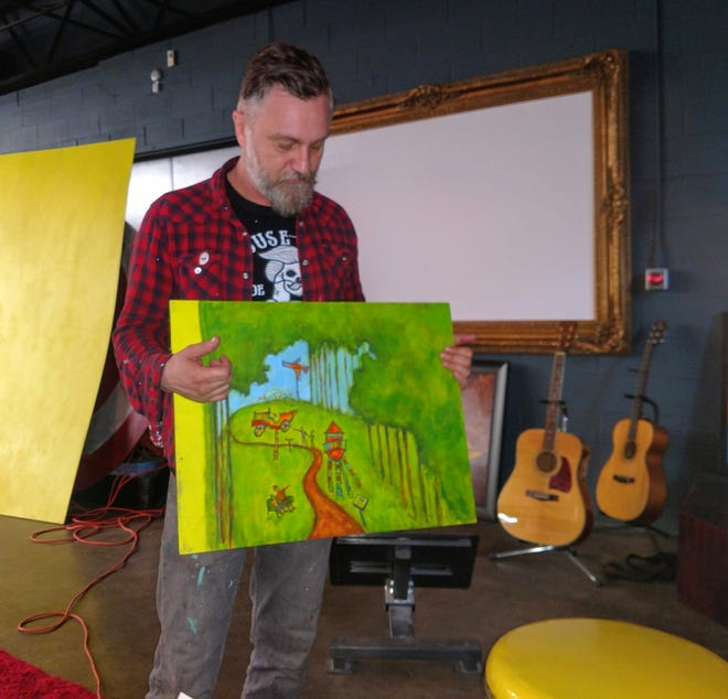 Tony Roko holds up an artistic vision of what he hopes to bring to the Wilcox Mill property in Plymouth. The Art Foundation, launched by Roko, is in the process of purchasing the former mill from Wayne County.