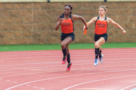 Northville's Marisa Porco hands off to Angel McCray in the 4x100 relay.