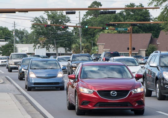 Heavy traffic fills the intersection of Creighton Road and Ninth Avenue in Pensacola on Tuesday.