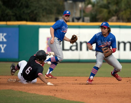 West Florida High School's Gavin Coles (No. 6) takes second base as Pace High School's Caleb Vincent, (No. 24) and Aidan Gilroy, (No. 6) cover the bag during the Battle of the Bay tournament at Blue Wahoos Stadium on Tuesday, March 12, 2019. Running since 2012, the Battle of the Bay series expanded to three matchups in 2019, including games between Pensacola Catholic and Gulf Breeze as well as Escambia and Milton.