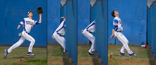 Pine Forest right fielder Chase Gullatt (5) makes a running catch before running into the fence in a game against Christian Educational Consortium at Pine Forest High School in Pensacola on Wednesday, April 3, 2019. Pine Forest baseball secured its best season in 12 years with a district title and region final appearance.