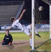 Gulf Breeze goalie Trevor Isakson (0) and Zach McLouth (14) can't keep the ball out of the goal as West Florida takes a 2-0 lead during the District 1-3A boys soccer tournament final at Gulf Breeze High School on Friday, Feb. 1, 2019.  Danny Ramos scored a hat trick for West Florida to lead the Jaguars to a 3-1 district title, their second and only championships in program history.
