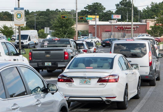 Traffic backs up along University Parkway at the intersection of North Davis Highway in Pensacola on Tuesday.