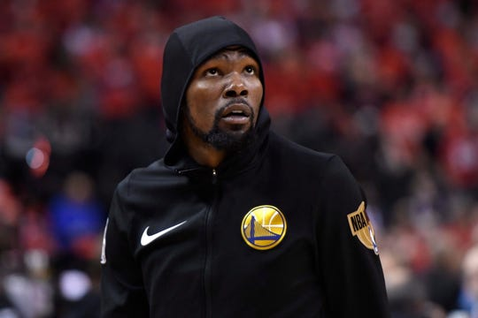 Golden State Warriors forward Kevin Durant (35) warms up before Game 5 of the NBA Finals against the Toronto Raptors in Toronto, Monday, June 10, 2019. (Frank Gunn/The Canadian Press via AP)