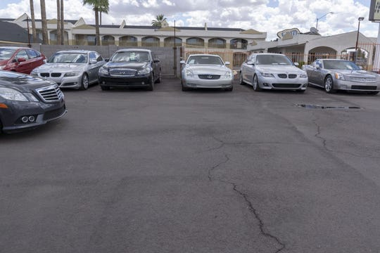 An investigation found an Arizona dealership resold cars without paying off loans or transferring title.