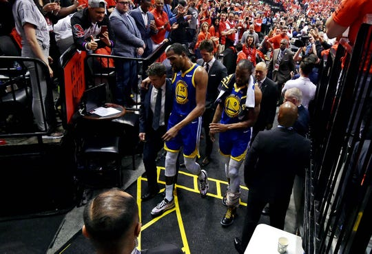 Golden State Warriors forward Kevin Durant (35) walks to the locker room during the second quarter against the Toronto Raptors in game five of the 2019 NBA Finals at Scotiabank Arena.