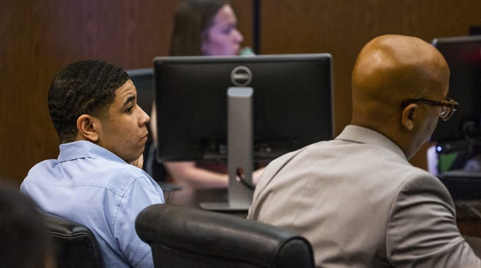 Hezron Parks, who is on trial for the murder of off-duty Tempe Fire Captain Kyle Brayer, looks around in the Phoenix courtroom of Maricopa County Superior Court Judge George H. Foster, Jr., Monday, June 10, 2019.  The jury was given instructions and opening statements were made by prosecutor Jordan Smith and defense attorney Stephen Crawford, right.