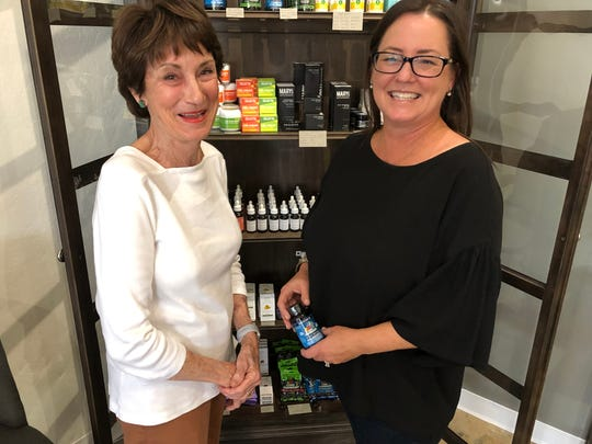 Phoenix resident Genevieve Hendricks, left, poses with Kaya Hemp Co. owner Cathleen Mitchell, right, after Hendricks purchases CBD products. Hendricks is a repeat customer of Mitchell's.