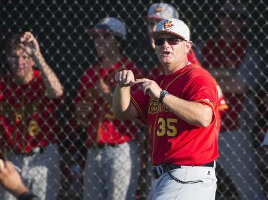 Chaparral baseball coach Sam Messina signals against Corona del Sol during the second round of the high school state tournament in Tempe May 3, 2016.