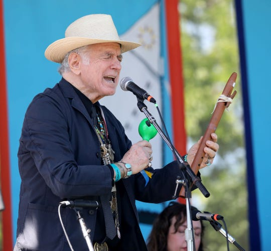 "David Amram sings with a group of musicians during a ""Songs for Pete & Toshi"" performance at Clearwater's Great Hudson River Revival at Croton Point Park, June 16, 2018."