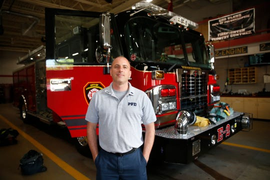 City of Poughkeepsie Fire Department Lieutenant Chris Burke beside Engine No. 2 at the Public Safety Building on June 11, 2019.